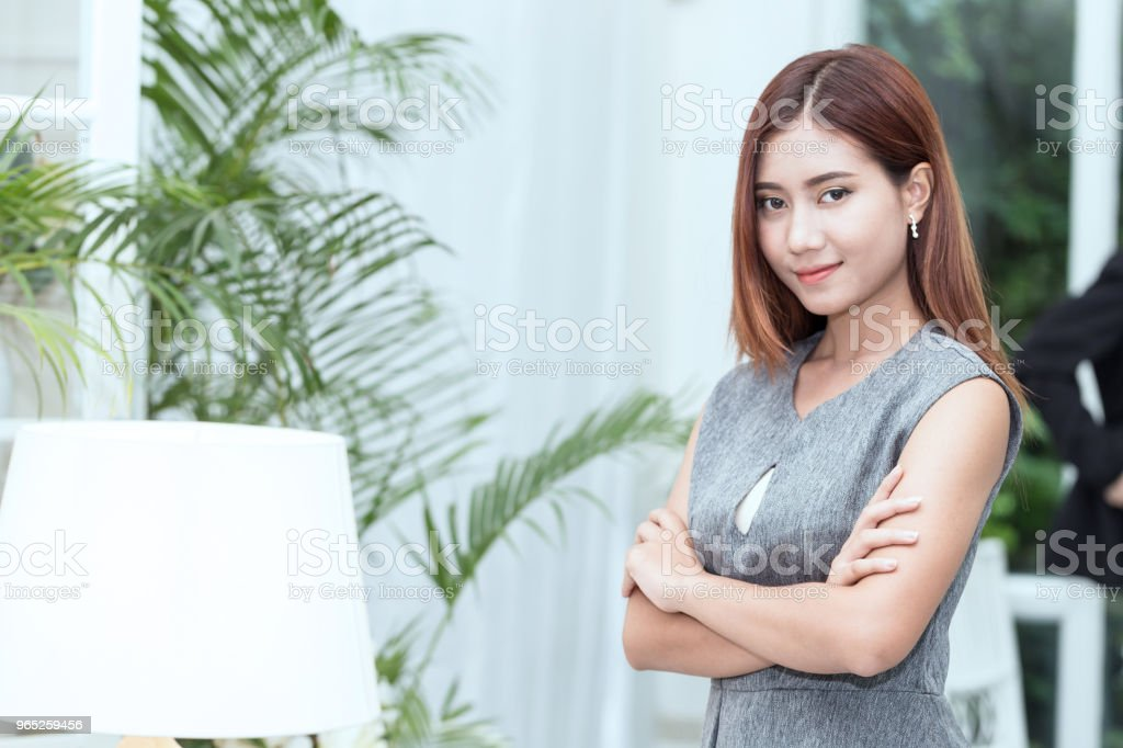 Beautiful Attractive Business Asian woman smile and cross arm feeling so happiness and confident,Business concept royalty-free stock photo