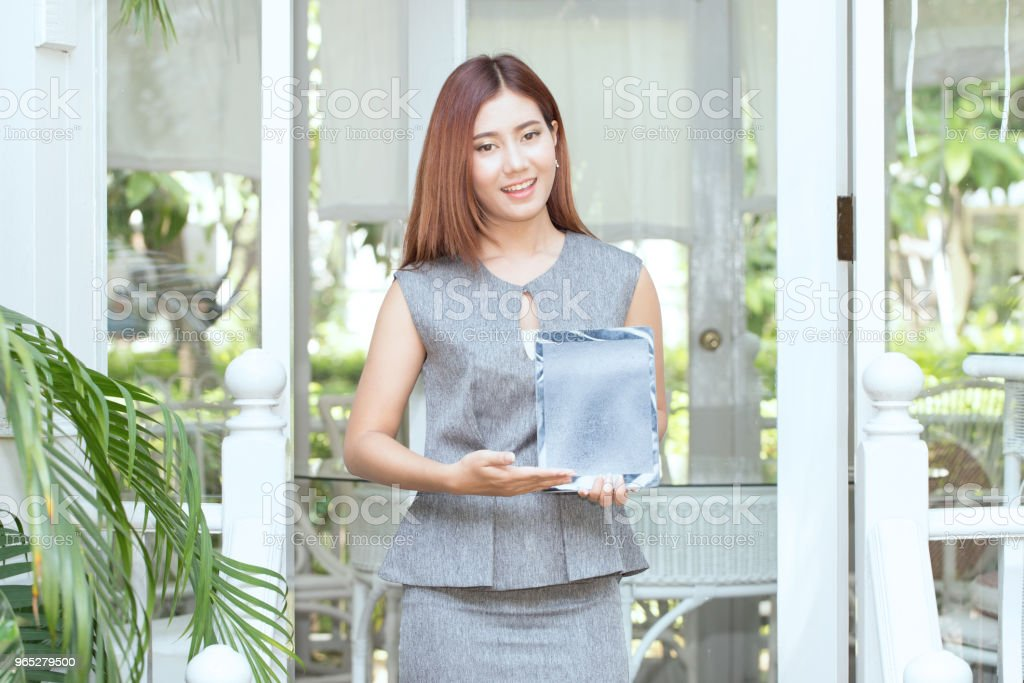 Beautiful Attractive Business Asian woman smile and showing computer tablet royalty-free stock photo
