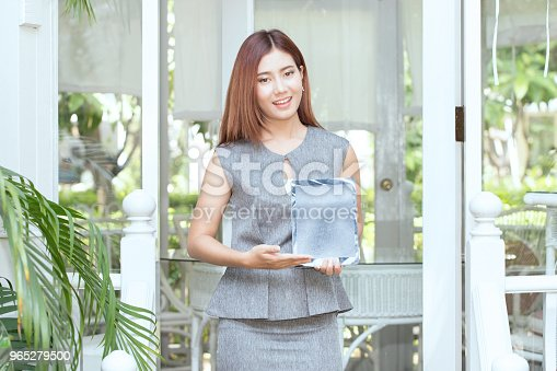 Beautiful Attractive Business Asian Woman Smile And Showing Computer Tablet Stock Photo & More Pictures of Adult