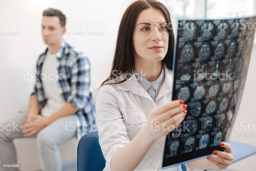 Beautiful attractive doctor holding an X ray photo stock photo