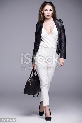 istock Beautiful attractive woman in elegant business clothes 604349380