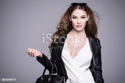 istock Beautiful attractive woman in elegant business clothes 604349474