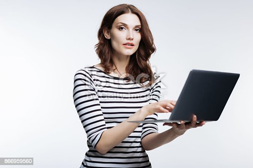 istock Beautiful auburn-haired woman working on laptop 866959560