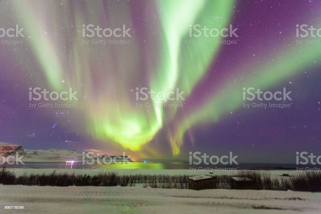 Beautiful Aurora Borealis or better known as The Northern Lights view in Iceland during winter stock photo