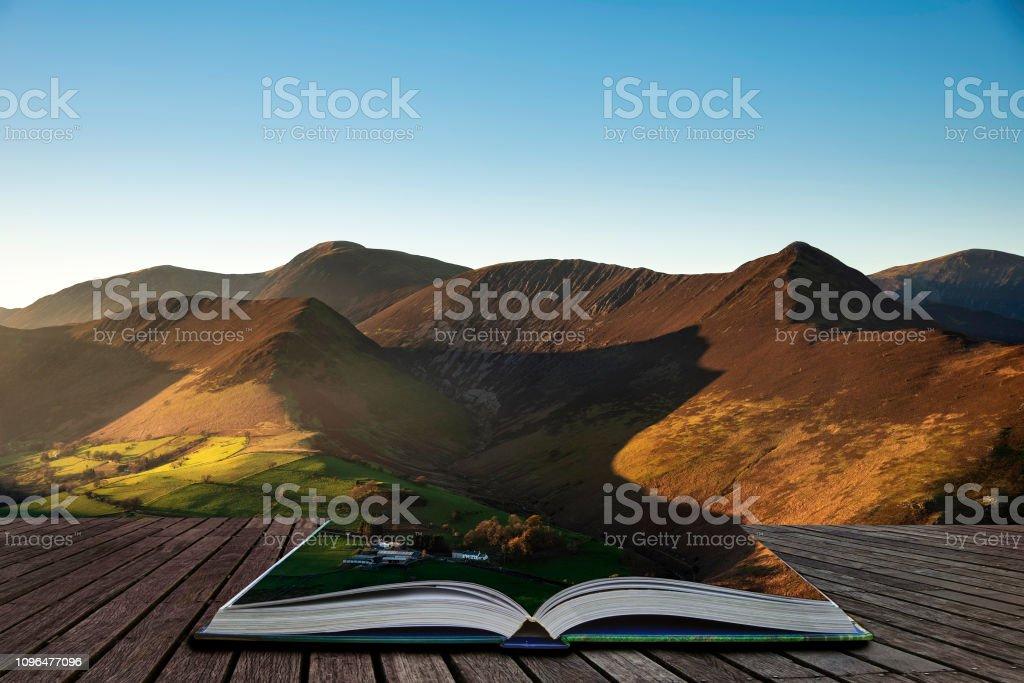 Stunning landscape image of sun beams lighting up small area of...