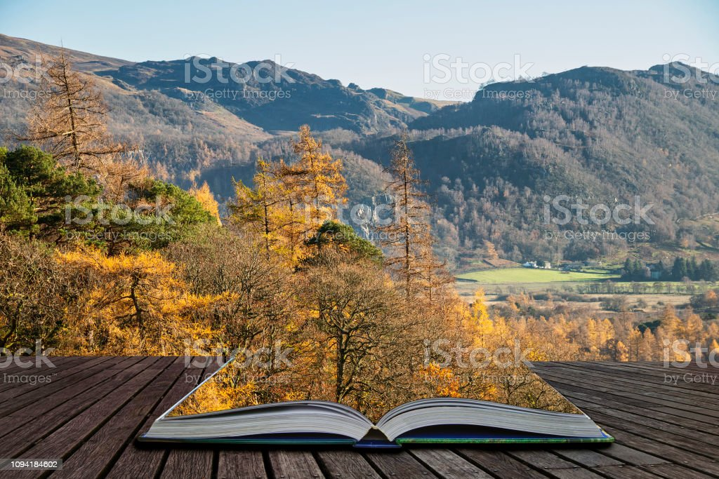 Beautiful Autumn Fall landscape image of the view from Catbells near Derwentwater in the Lake District with vivid Fall colors all around the contryside scene coming out of pages of open story book stock photo