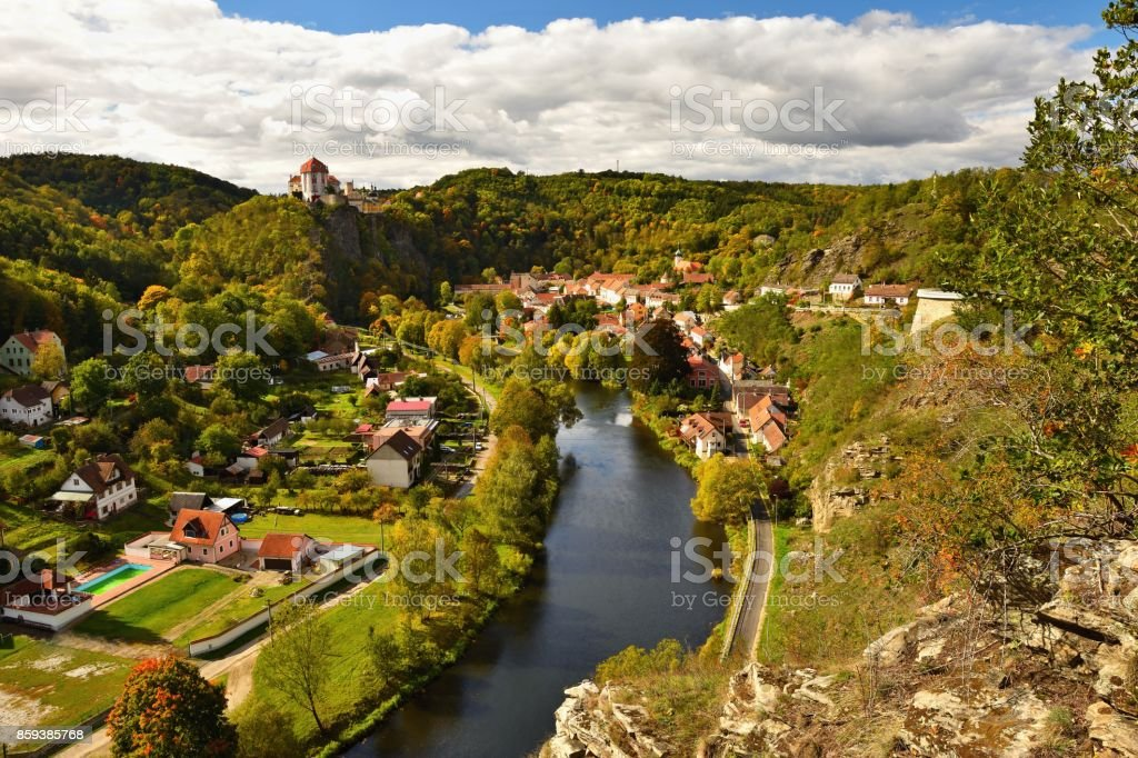 Beautiful autumn landscape with river, castle and blue sky with clouds and sun. Vranov nad Dyji (Vranov above Thaya) chateau, river Thaya, Czech Republic stock photo