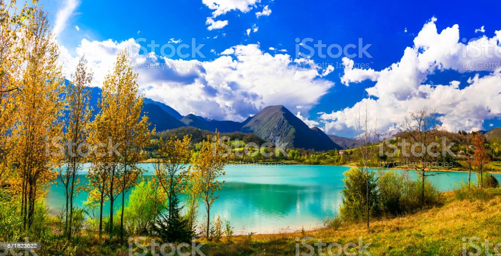 Beautiful autumn landscape with turquoise lake Lago di Castel San Vincenzo in Molise, Italy stock photo