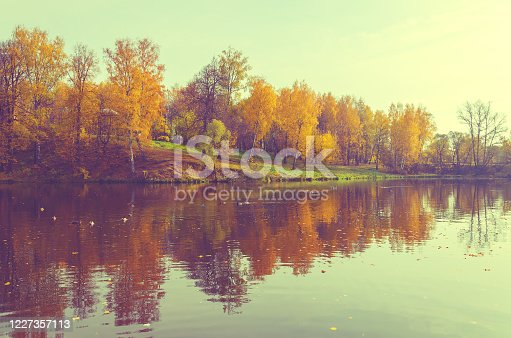 Beautiful reflection of trees with red and orange foliage
