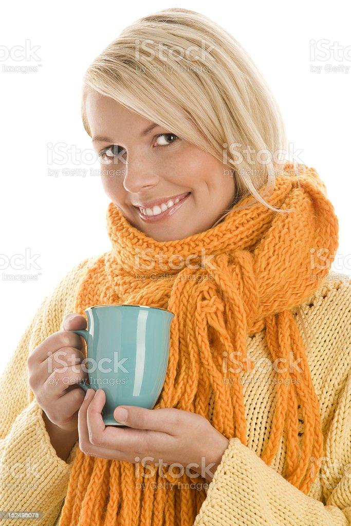 Beautiful autumnal woman holding mug with hot beverage royalty-free stock photo