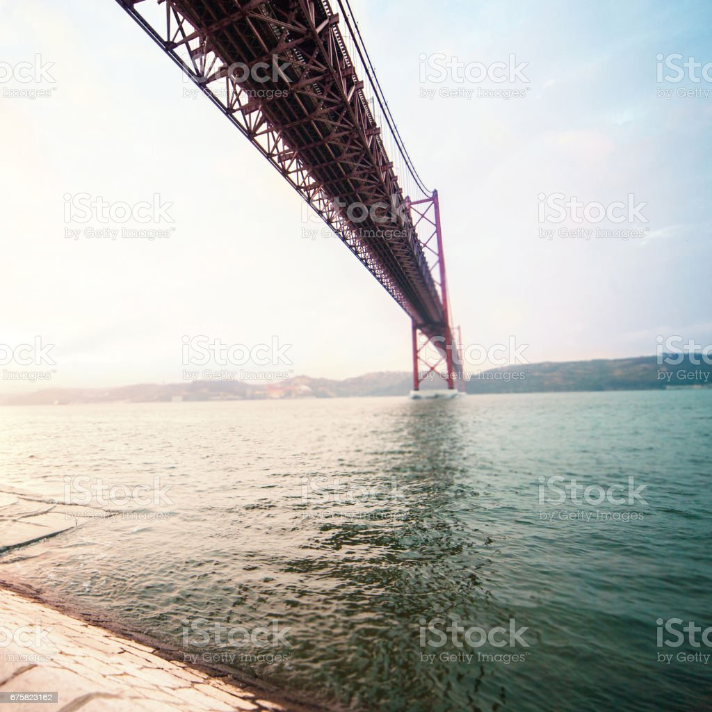 Beautiful B ridge over  river  with wide angle view. The 25 de Abril bridge over Tagus river and Christ monument in Lisbon, Portugal stock photo