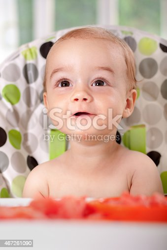 149051793 istock photo Beautiful baby eating watermelon 467261090