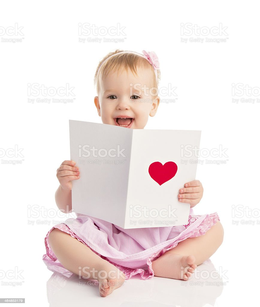 beautiful baby girl and cute valentine postcard with red hear stock photo