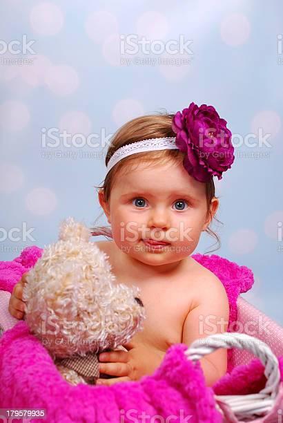 Photo of beautiful baby girl in wicker basket ,10 months