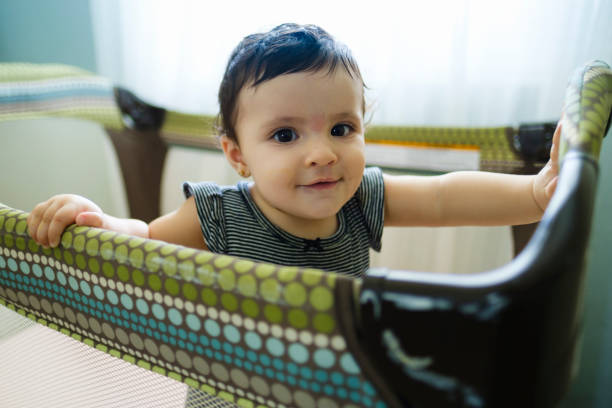 beautiful baby girl - playpen stock pictures, royalty-free photos & images