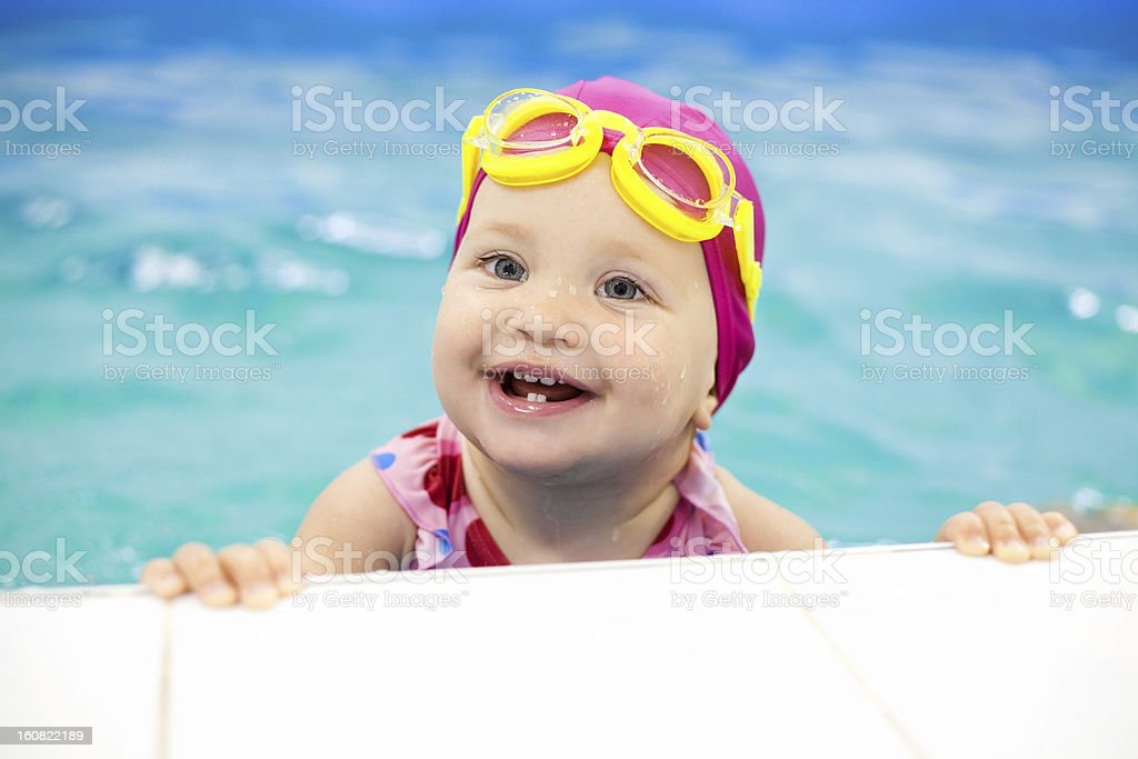 Beautiful baby in her swim class smiling stock photo