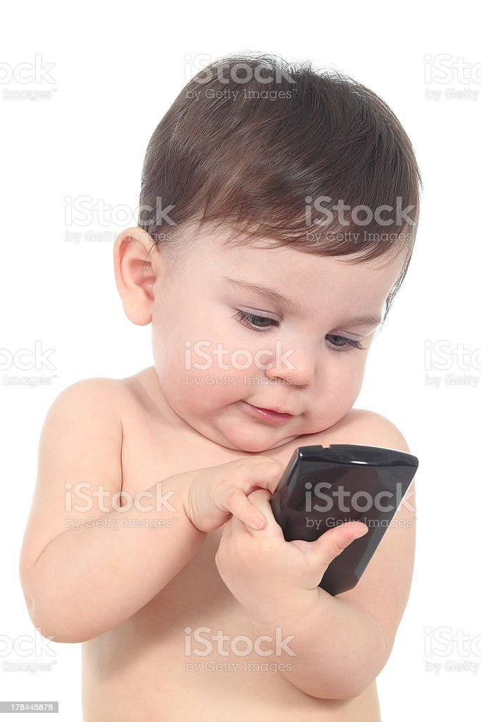 Beautiful baby playing and touching a mobile phone royalty-free stock photo