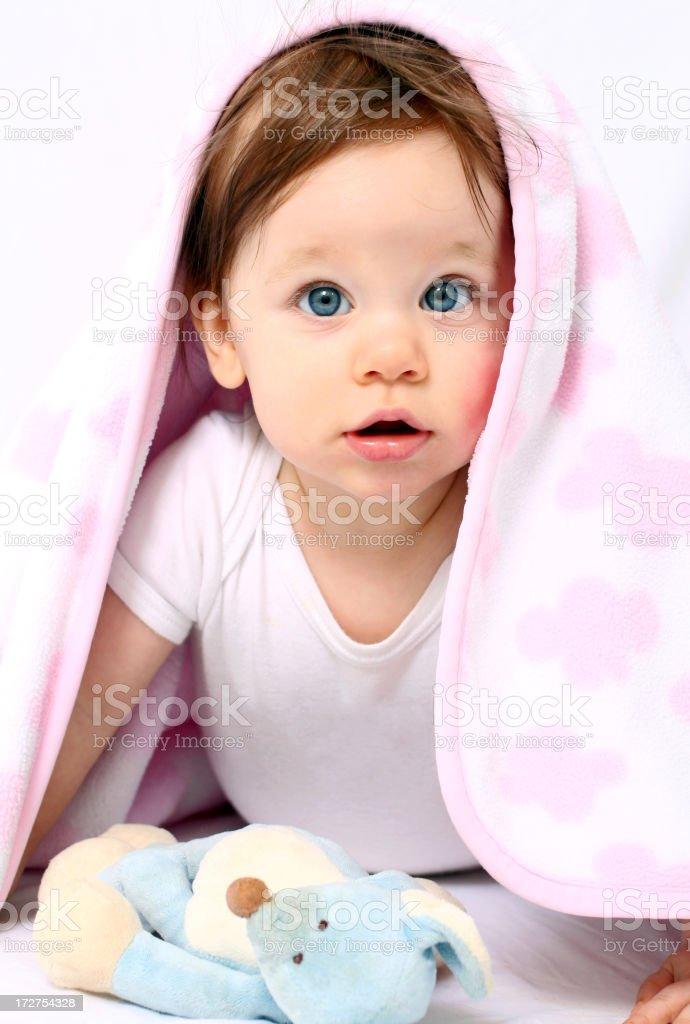 Beautiful baby under blanket royalty-free stock photo