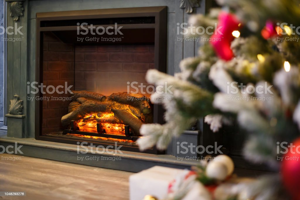 Burning Christmas Tree.Beautiful Background Of Christmas Tree At Living Room With