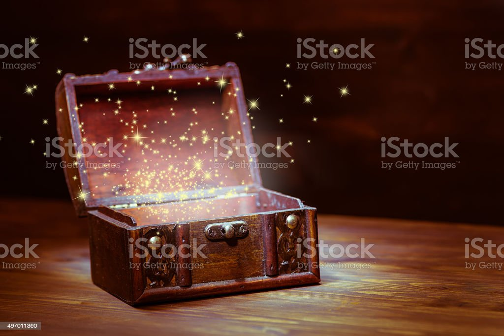 beautiful background of mystery chest with light miracle on wood stock photo