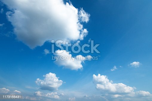 Beautiful background. White clouds in the blue sky.
