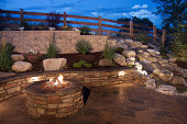 An amazing and beautiful backyard fire pit, seat wall and water feature. Inspiring ideas for backyards