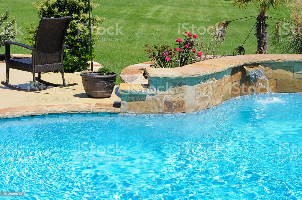 Beautiful backyard swimming pool stock photo