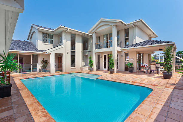 beautiful backyard with pool in australian mansion - stately home stock photos and pictures