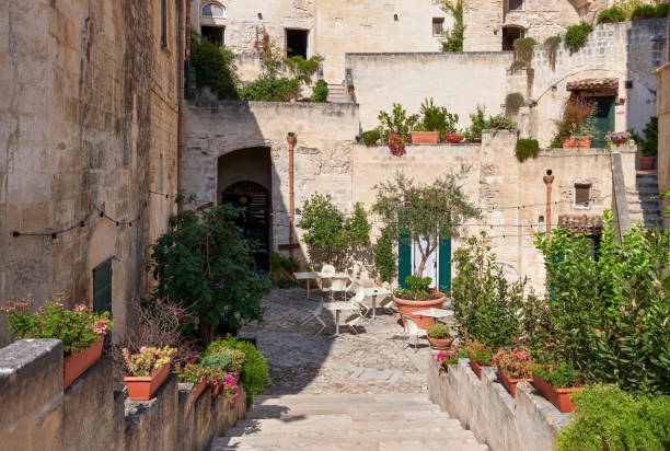 Beautiful backyards decorated with trees and flowers at old town of matera stock photo