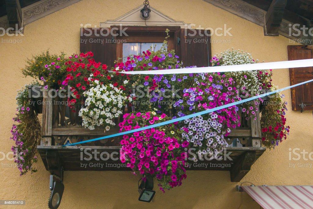 Beautiful balcony with flowers in the center of Livigno, Lombardy stock photo