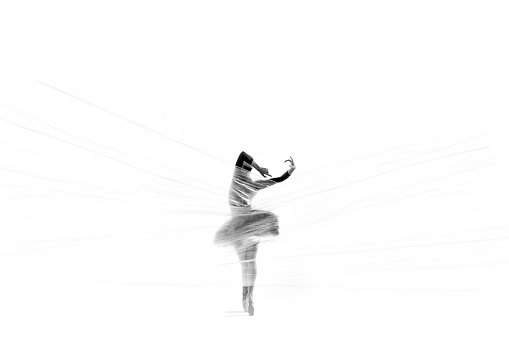 1042335572 istock photo Beautiful ballerina dancing classical ballet behind thin nylon 1153282848