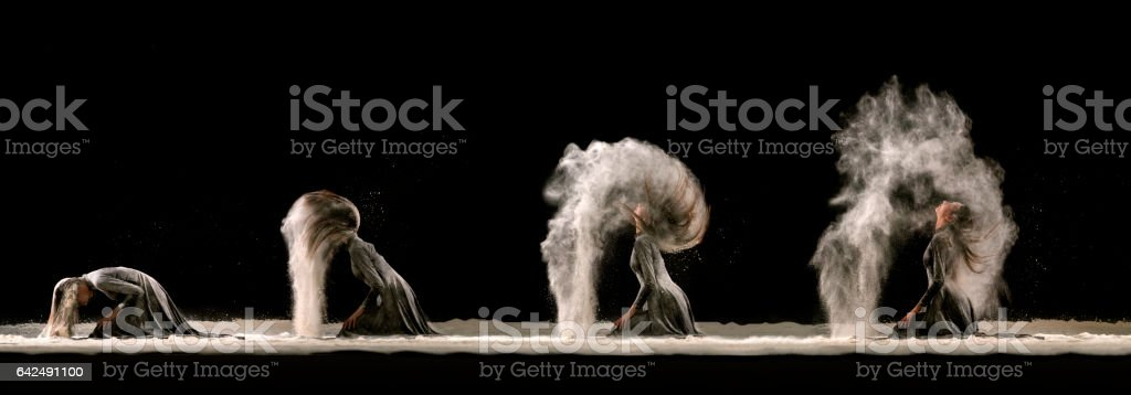 Beautiful ballerina dancing in powder snow stock photo