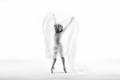 1042335572 istock photo beautiful ballerina dancing with transparent thin nylon 1129571485