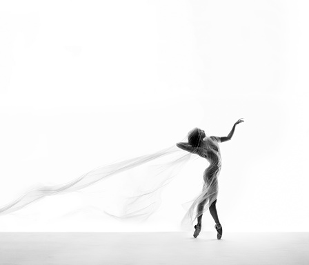 1042335572 istock photo beautiful ballerina dancing with transparent thin nylon 1129571488