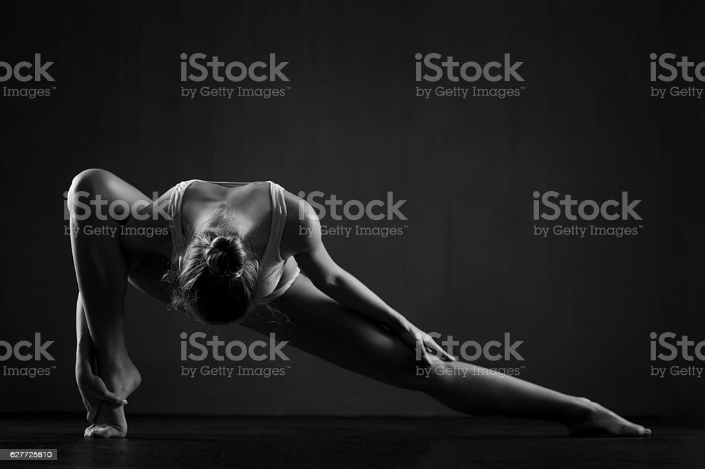 Beautiful ballerina exercises stock photo