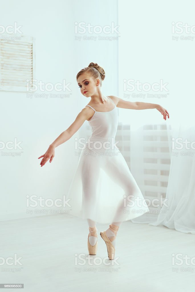Beautiful Ballerina Is Posing And Dancing In A White Studio Full Of Light The Photo Greatly Reflects The Incomparable Beauty Of A Classical Ballet Art Stock Photo Download Image Now Istock