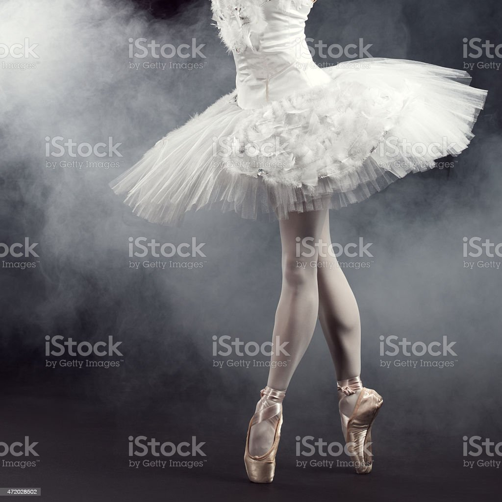 Beautiful ballerina performing on the stage stock photo