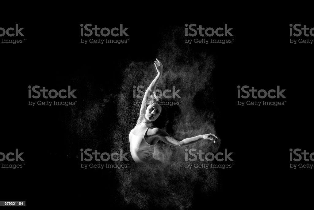 Beautiful ballerina portrait of dancing  dancing with powder on stage stock photo