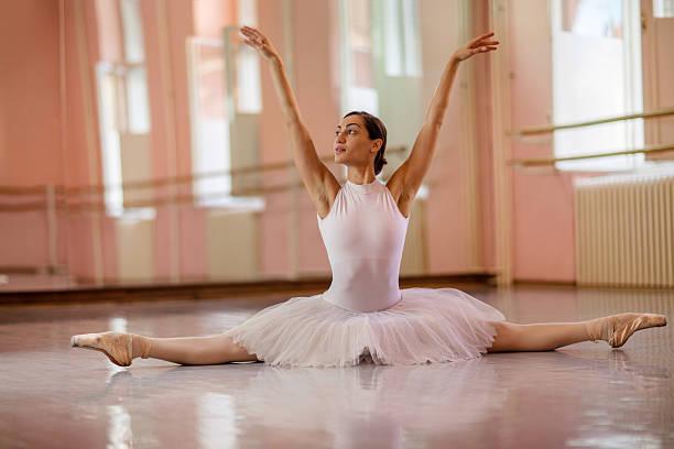 Beautiful ballerina posing in in ballet studio. stock photo