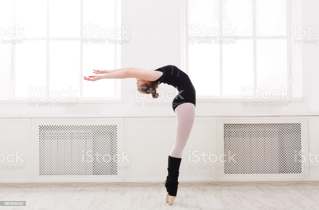 Beautiful ballerina stands in ballet croise royalty-free stock photo