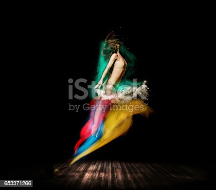 istock Beautiful ballet dancer, appear from magic lamp on stage 653371266