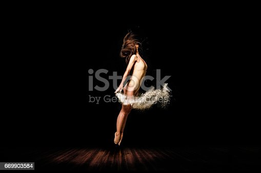 The rock that hit the ballerine is shattered. Ballet Dancer Concept on Stage - 2017