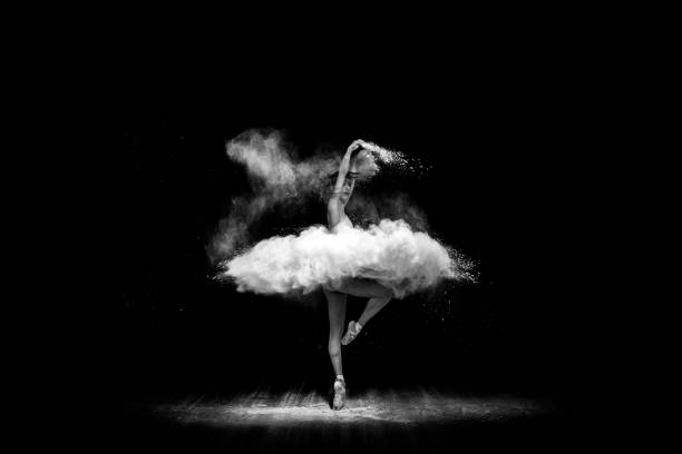 Beautiful ballet dancer, dancing with powder on stage stock photo