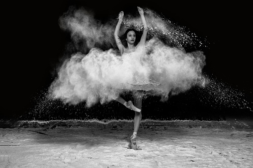 1042335572 istock photo Beautiful ballet dancer, dancing with powder on stage 913765522