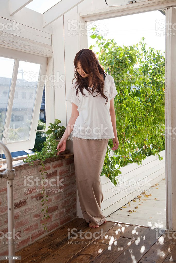 Beautiful barefoot Japanese girl in a countryhouse stock photo