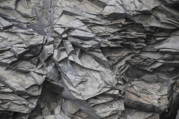 Beautiful basalt formations on Reynisfjara beach in Iceland Black basalt formations of Reynisdrangar on the famous black beach in Iceland, near the village Vik black sand stock pictures, royalty-free photos & images