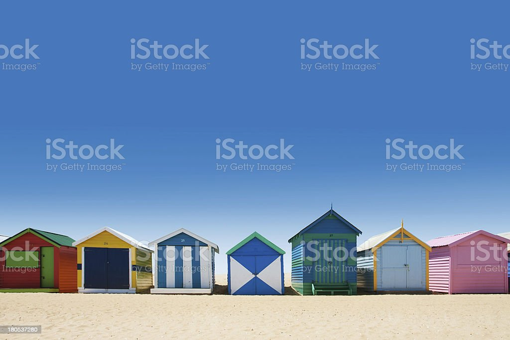Beautiful bathing houses on white sand beach stock photo