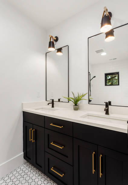Beautiful bathroom interior in new luxury home with vanity, mirror, and cabinets