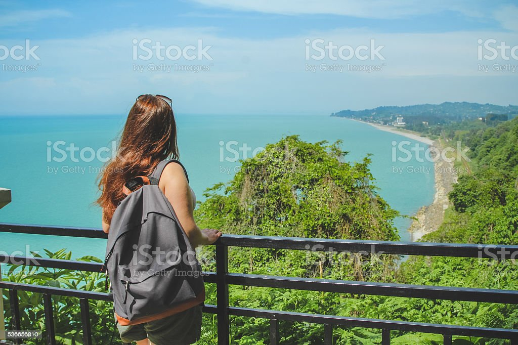 Beautiful bay and travel girl with backpack in Georgia stock photo