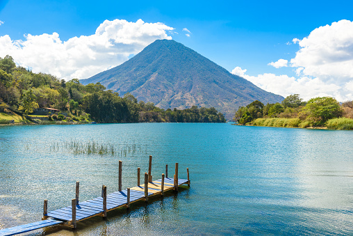 istock Beautiful bay of Lake Atitlan with view to Volcano San Pedro  in highlands of Guatemala, Central America 870575552